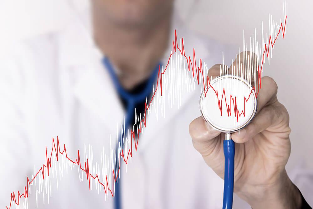 Vermögensverwaltung für Ärzte - Stethoskop und Kurswert
