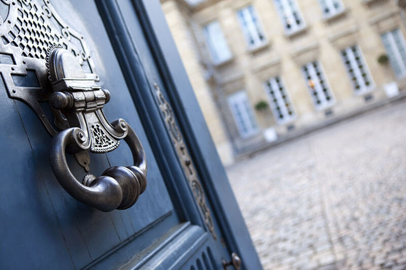 Asset management for foundations - Old gate is open to reveal a courtyard